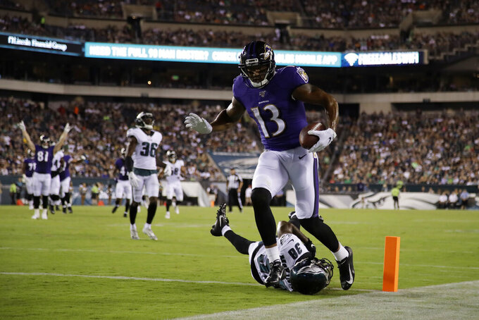 Baltimore Ravens' Michael Floyd (13) scores a touchdown past Philadelphia Eagles' Jeremiah McKinnon (38) during the first half of a preseason NFL football game, Thursday, Aug. 22, 2019, in Philadelphia. (AP Photo/Matt Rourke)