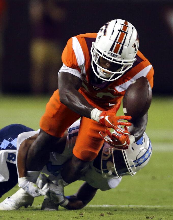 Virginia Tech's Chamarri Conner (25) intercepts a pass intended for North Carolina's Josh Downs (11) during the second half of an NCAA college football game Friday, Sept. 3, 2021, in Blacksburg, Va. (Matt Gentry/The Roanoke Times via AP)