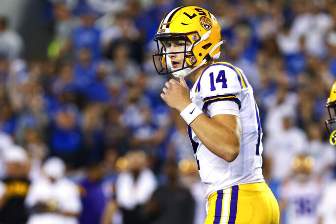 LSU quarterback Max Johnson (14) calls a play during the first half of the team's NCAA college football game against Kentucky in Lexington, Ky., Saturday, Oct. 9, 2021. (AP Photo/Michael Clubb)