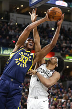 Indiana Pacers center Myles Turner (33) is fouled by Brooklyn Nets center Jarrett Allen (31) while shooting during the first half of an NBA basketball game in Indianapolis, Monday, Feb. 10, 2020. (AP Photo/Michael Conroy)