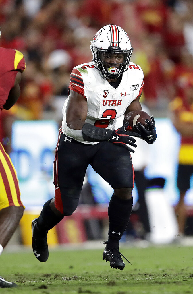 Utah running back Zack Moss carries against Southern California during the first half of an NCAA college football game Friday, Sept. 20, 2019, in Los Angeles. (AP Photo/Marcio Jose Sanchez)