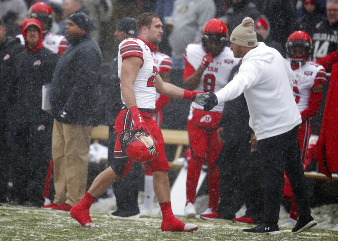 Utah linebacker Chase Hansen, left, heads off the field after he was ejected for targeting while sacking Colorado quarterback Steven Montez in the first half of an NCAA college football game Saturday, Nov. 17, 2018, in Boulder, Colo. (AP Photo/David Zalubowski)