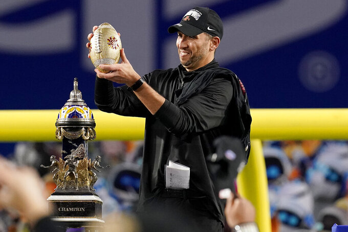 Iowa State head coach Matt Campbell holds the trophy after the Fiesta Bowl NCAA college football game against Oregon, Saturday, Jan. 2, 2021, in Glendale, Ariz. Iowa State won 34-17. (AP Photo/Ross D. Franklin)