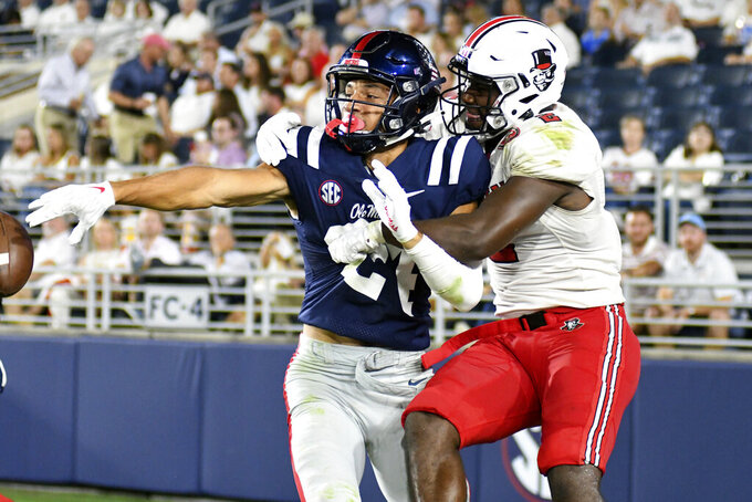 Mississippi defensive back Deane Leonard (24) knocks down a pass to Austin Peay wide receiver Baniko Harley (2) during an NCAA college football game in Oxford, Miss., Saturday, Sept. 11, 2021. (AP Photo/Bruce Newman)