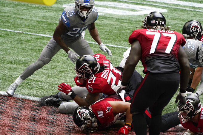 Atlanta Falcons running back Todd Gurley (21) falls into the end zone for a touchdown against the Detroit Lions during the first half of an NFL football game, Sunday, Oct. 25, 2020, in Atlanta. (AP Photo/John Bazemore)