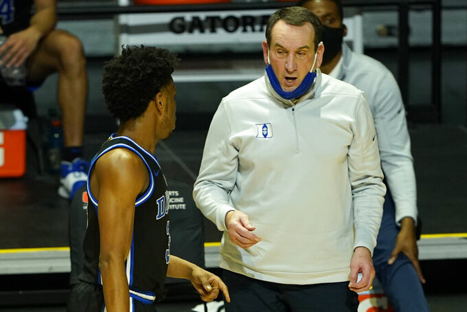 Duke head coach Mike Krzyzewski talks to guard Jeremy Roach (3) during the second half of an NCAA college basketball game against Miami, Monday, Feb. 1, 2021, in Coral Gables, Fla. (AP Photo/Marta Lavandier)