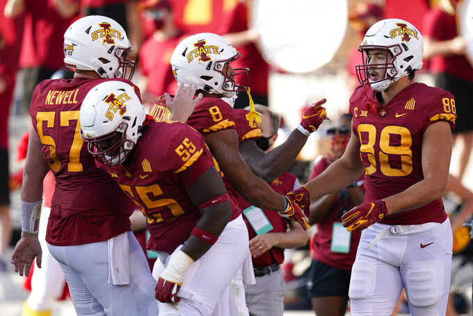 Iowa State tight end Charlie Kolar (88) celebrates with teammates after catching a 13-yard touchdown pass during the second half of an NCAA college football game against Texas Tech, Saturday, Oct. 10, 2020, in Ames, Iowa. Iowa State won 31-15. (AP Photo/Charlie Neibergall)