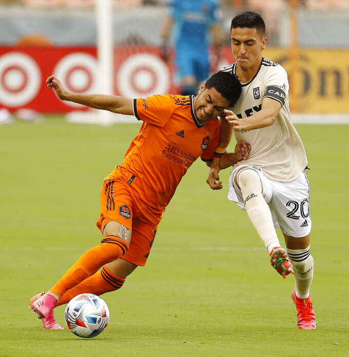 Houston Dynamo midfielder Memo Rodriguez leans into Los Angeles FC midfielder Eduard Atuesta during the second half of an MLS soccer game, Saturday, May 1, 2021, at BBVA Stadium in Houston. (Kevin M. Cox/The Galveston County Daily News via AP)