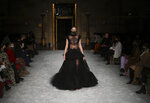 A model walks the runway at the Christian Siriano Fall/Winter 2021 at Gotham Hall during New York Fashion Week on Thursday, Feb. 25, 2021, in New York. (Photo by Evan Agostini/Invision/AP)