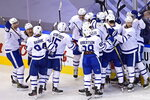 Toronto Maple Leafs players celebrate their victory over the Columbus Blue Jackets in overtime of an NHL hockey playoff game Friday, Aug. 7, 2020, in Toronto. (Frank Gunn/The Canadian Press via AP)