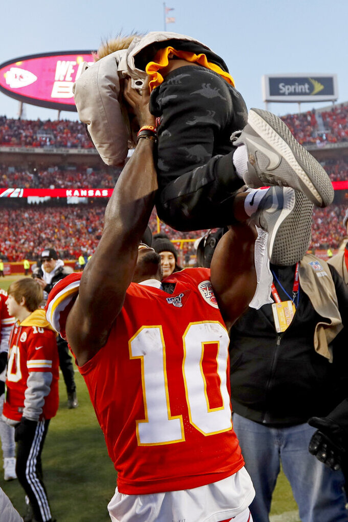 Kansas City Chiefs' Tyreek Hill celebrates after the NFL AFC Championship football game against the Tennessee Titans Sunday, Jan. 19, 2020, in Kansas City, MO. The Chiefs won 35-24 to advance to Super Bowl 54. (AP Photo/Charlie Neibergall)