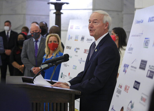Arkansas Gov. Asa Hutchinson speaks Wednesday Aug. 19, 2020, in Little Rock, Ark., during a news conference at the Capitol to reveal a draft of a proposed hate-crime law that will be considered during the next legislative session. (Staton Breidenthal/The Arkansas Democrat-Gazette via AP)