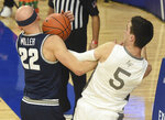 Utah State's Brock Miller and Air Force's Chris Joyce fight for the ball during the first half of an NCAA college basketball game Thursday, Dec. 31, 2020, at Air Force Academy, Colo. (Jerilee Bennett/The Gazette via AP)