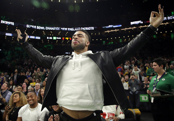"FILE - In this Feb. 7, 2019, file photo, New England Patriots football player Kyle Van Noy acknowledges the fans as the Patriots Super Bowl victory is honored during a break in an NBA basketball game between the Boston Celtics and the Los Angeles Lakers, in Boston. Van Noy had plenty of nice things to say about his former team. Of course, it's been his own career that's taken off since he left Detroit. ""It feels good to come back a winner and say hi to people I haven't seen in a while,"" the New England linebacker said. (AP Photo/Elise Amendola, File)"