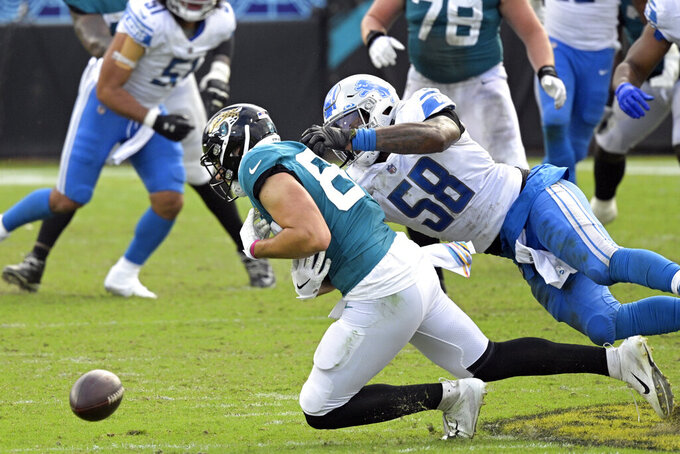 Detroit Lions linebacker Jamie Collins Sr. (58) breaks up a pass intended for Jacksonville Jaguars tight end Tyler Davis, left, during the second half of an NFL football game, Sunday, Oct. 18, 2020, in Jacksonville, Fla. (AP Photo/Phelan M. Ebenhack)
