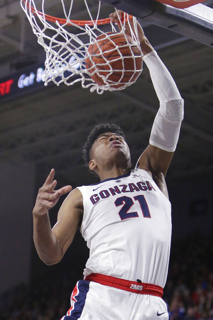 Gonzaga forward Rui Hachimura (21) dunks during the first half of an NCAA college basketball game against Santa Clara in Spokane, Wash., Saturday, Jan. 5, 2019. (AP Photo/Young Kwak)