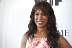 FILE - In this June 13, 2018 file photo, Channing Dungey arrives at the Women In Film Crystal and Lucy Awards in Beverly Hills, Calif.  Dungey has been named chairman, Warner Bros. Television Group, starting her tenure at the studio early next year. The news was announced today by Ann Sarnoff, Chair and CEO, WarnerMedia Studios and Networks Group, to whom she will report. Dungey will succeed Peter Roth who will be stepping down from his Studio responsibilities running the TV Group and its operating divisions in early 2021.(Photo by Chris Pizzello/Invision/AP, File)