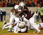 Georgia Tech quarterback Tobias Oliver (8) crosses the goal as Virginia Tech linebacker Rayshard Ashby (23) tries to stop him during the first half of an NCAA college football game in Blacksburg, Va., Thursday, Oct. 25, 2018. (AP Photo/Steve Helber)