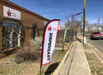 In this Wednesday, March 6, 2019 photo, the exterior of a medical marijuana dispensary is seen in Santa Fe, N.M. New Mexico took a step toward legalizing recreational marijuana when its House approved a bill that would allow state-run stores and require customers to carry a receipt with their cannabis or face penalties. The measure, narrowly approved Thursday, March 7, 2019, following a late-night floor debate, mixes major provisions of a Republican-backed Senate bill that emphasizes aggressive regulation with a draft by Democrats concerned about the U.S. war on drugs. (AP Photo/Morgan Lee)