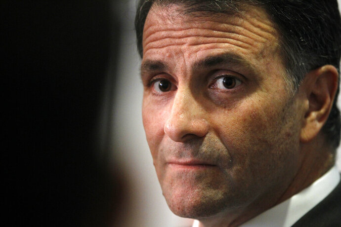 FILE - This Feb. 2, 2012 file photo shows former lobbyist Jack Abramoff speaking in Washington. U.S. officials say Abramoff, a once-powerful lobbyist who spent time in federal prison for fraud and corruption, has been charged in a San Francisco court in an investor fraud case involving cryptocurrency and lobbying disclosure. U.S. Attorney David Anderson said Thursday, June 25, 2020, Abramoff of Silver Spring, Maryland, has agreed to plead guilty to criminal conspiracy charges and could face up to five years in jail. (AP Photo/Charles Dharapak, File)