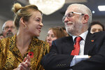 Britai's Labour Party leader Jeremy Corbyn, right reacts with Laura McAlpine, the party's candidate for Harlow during an event, at the Park Inn By Radisson Harlow hotel, in Harlow, England, Tuesday, Nov. 5, 2019. (Stefan Rousseau/PA via AP)