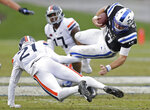 Virginia safety Juan Thornhill (21) tackles Duke quarterback Daniel Jones (17) during the second half of an NCAA college football game in Durham, N.C., Saturday, Oct. 20, 2018. Virginia won 28-14. (AP Photo/Gerry Broome)