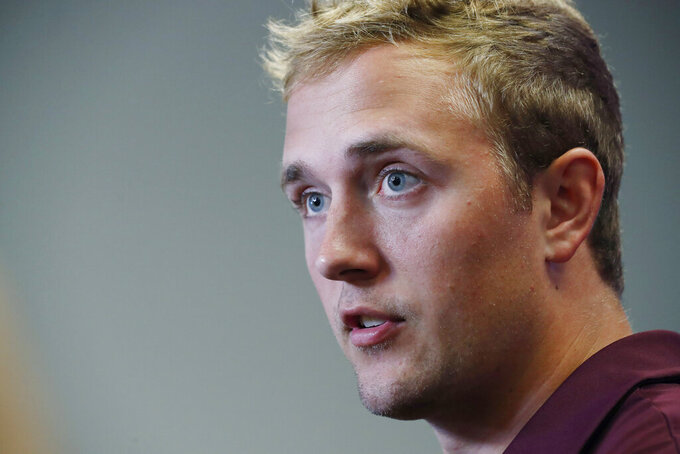 In this Aug. 10, 2019, file photograph, Mississippi State quarterback Tommy Stevens answers a reporter's question about competition among quarterbacks in preseason camp as they prepare for the upcoming NCAA college football season during media day, in Starkville, Miss. (AP Photo/Rogelio V. Solis, File)
