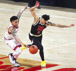 Rutgers' Aiden Terry, left, collides with Nebraska's Trey McGowens as the chase down the ball in the first half of an NCAA college basketball game Monday, March 1, 2021, in Lincoln, Neb. (Kenneth Ferriera/Lincoln Journal Star via AP)