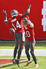 Tampa Bay Buccaneers wide receiver Scott Miller (10) celebrates with wide receiver Chris Godwin (14) after Miller caught a 48-yard touchdown pass from Tom Brady during the first half of an NFL football game against the Minnesota Vikings Sunday, Dec. 13, 2020, in Tampa, Fla. (AP Photo/Mark LoMoglio)