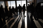 People wait in line to hear Democratic presidential candidate Sen. Bernie Sanders, I-Vt., speak at a campaign event Sunday, Jan. 26, 2020, in Storm Lake, Iowa. (AP Photo/John Locher)