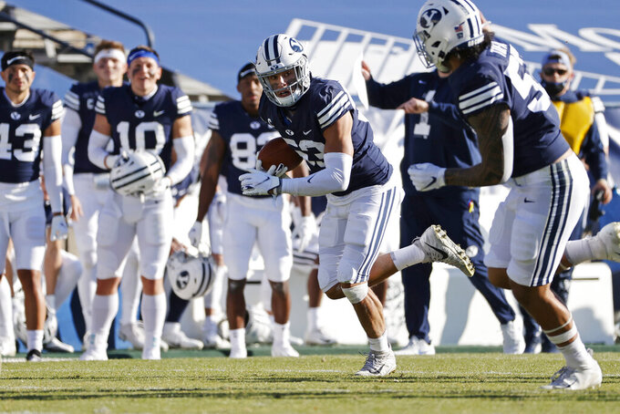 BYU linebacker Isaiah Kaufusi (53) runs with a fumble recovery against North Alabama in the second quarter during an NCAA college football game Saturday, Nov. 21, 2020, in Provo, Utah. (AP Photo/Jeff Swinger, Pool)