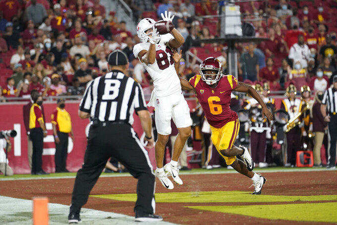 Stanford wide receiver Brycen Tremayne (81) catches a pass for a touchdown over Southern California cornerback Isaac Taylor-Stuart (6) during the first half of an NCAA college football game Saturday, Sept. 11, 2021, in Los Angeles. (AP Photo/Marcio Jose Sanchez)