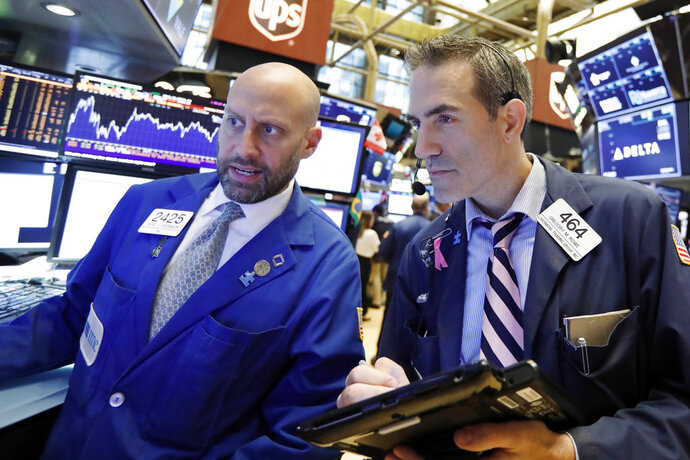 Specialist Meric Greenbaum, left, and trader Gregory Rowe work on the floor of the New York Stock Exchange, Friday, Sept. 14, 2018. Global stock markets rose further on Friday on hopes that the United States and China will call time-out in their escalating trade feud. (AP Photo/Richard Drew)