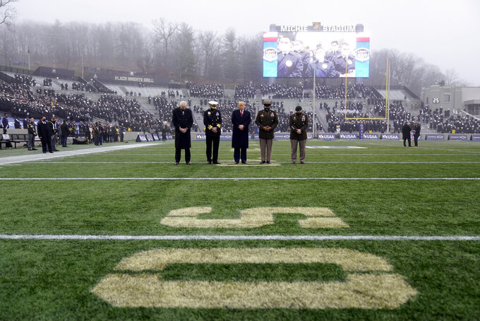 President Donald Trump stands on the field before the 121st Army-Navy Football Game in Michie Stadium at the United States Military Academy, Saturday, Dec. 12, 2020, in West Point, N.Y. (AP Photo/Andrew Harnik)