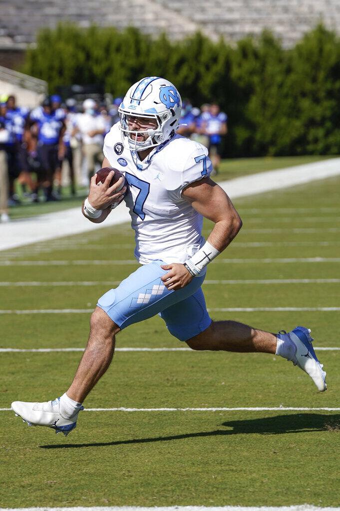 North Carolina  quarterback Sam Howell (7) scores a touchdown against the Duke Blue during the first half of an NCAA college football game at Wallace Wade Stadium, Saturday, Nov. 7, 2020, in Durham, N.C. (Jim Dedmon/Pool Photo via AP)