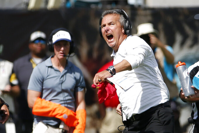 Jacksonville Jaguars head coach Urban Meyer reacts to a play as he watches a video replay of a call he disputed during the second half of an NFL football game, Sunday, Oct. 10, 2021, in Jacksonville, Fla. (AP Photo/Stephen B. Morton)