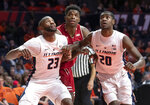 Illinois guards Aaron Jordan (23) and Da'Monte Williams (20) and Wisconsin guard Khalil Iverson wait for a rebound during the second half of an NCAA college basketball game in Champaign, Ill., Wednesday, Jan. 23, 2019. (AP Photo/Stephen Haas)