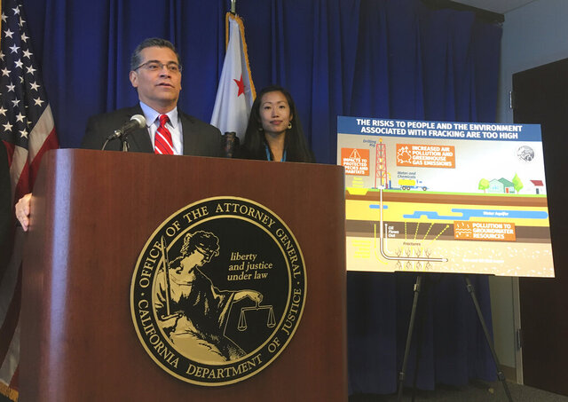 California Attorney General Xavier Becerra, left, with Deputy Attorney General Yvonne Chi, discusses the state's lawsuit challenging the Trump administration over the U.S. Bureau of Land Management's decision to open more than 1 million acres of public land to oil and gas drilling in the middle of the state, on Friday, Jan. 17, 2020, in Sacramento, Calif. Becerra said the federal government could allow more use of the controversial extraction method known as fracking without properly considering the consequences. (AP Photo/Don Thompson)