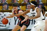 Utah forward Mikael Jantunen, left, drives to the basket as Colorado forward Evan Battey defends in the second half of an NCAA college basketball game Saturday, Jan. 30, 2021, in Boulder, Colo. (AP Photo/David Zalubowski)