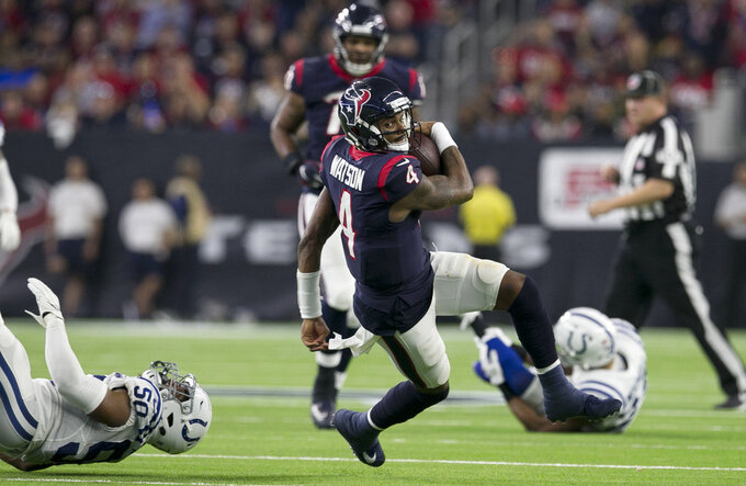 Houston Texans quarterback Deshaun Watson (4) runs against the Indianapolis Colts during the second half of an NFL wild card playoff football game, Saturday, Jan. 5, 2019, in Houston. (AP Photo/Michael Wyke)