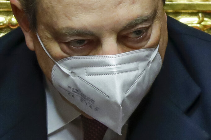 Italy's Prime Minister Mario Draghi attends a debate at the Senate, in Rome, Wednesday, Feb. 17, 2021, before submitting his government to a vote of confidence. (AP Photo/Andrew Medichini, Pool)
