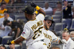 Pittsburgh Pirates' Michael Chavis, right, celebrates with Gregory Polanco after hitting a solo home run against the Arizona Diamondbacks during the third inning of a baseball game Tuesday, Aug. 24, 2021, in Pittsburgh. (AP Photo/Keith Srakocic)
