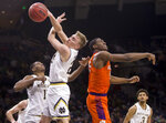 Notre Dame's Liam Nelligan, left, grabs a rebound next to Clemson's Trey Jemison during the first half of an NCAA college basketball game Wednesday, March 6, 2019, in South Bend, Ind. (AP Photo/Robert Franklin)