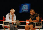 FILE - In this Aug. 16, 1995 file photo, former heavyweight champion Mike Tyson, right, shares a laugh with TV talk show host Larry King during the broadcasting of the