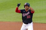 Washington Nationals Juan Soto gestures after hitting a two-run double during the first inning of the team's baseball game against the Atlanta Braves in Washington, Friday, Sept. 11, 2020. (AP Photo/Manuel Balce Ceneta)