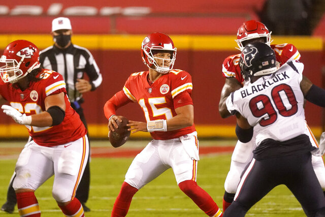 Kansas City Chiefs quarterback Patrick Mahomes (15) passes against the Houston Texans in the first half of an NFL football game Thursday, Sept. 10, 2020, in Kansas City, Mo. (AP Photo/Charlie Riedel)