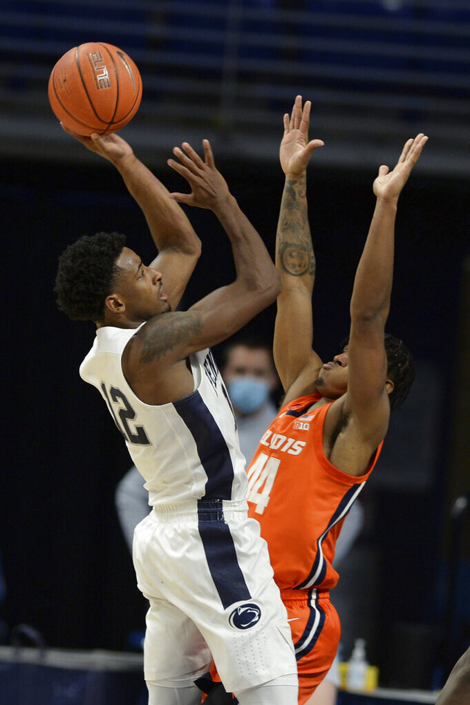 Penn State's Isaiah Brockington (12) shoots over Illinois' Adam Miller (44) during the second half of an NCAA college basketball game, Wednesday, Dec. 23, 2020, in State College, Pa. (AP Photo/Gary M. Baranec)