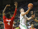 Oregon's Payton Pritchard, right, shoots past Houston's Justin Gorham, left, during the first half of an NCAA college basketball game in Eugene, Ore., Friday, Nov. 22, 2019. (AP Photo/Chris Pietsch)