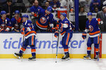New York Islanders center Casey Cizikas (53) and Leo Komarov (47) react with teammates after New York Rangers' Chris Kreider scored a goal during the third period of an NHL hockey game Thursday, Jan. 16, 2020, in Uniondale, N.Y. The Rangers won 3-2. (AP Photo/Frank Franklin II)