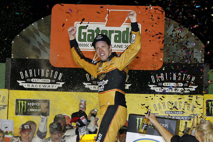 FILE - In this Sept. 2, 2018, file photo, Brad Keselowski celebrates in Victory Lane after winning the NASCAR Cup Series auto race at Darlington Raceway, in Darlington, S.C. Keselowski can't wait to get to Darlington Raceway _ and it's not just because he swept race weekend the last time NASCAR's best showed up. This the fifth year the Southern 500 is NASCAR's throwback weekend, kind of an Old Timer's Day for fans and competitors to honor and mimic the greats of the past.(AP Photo/Terry Renna, File)